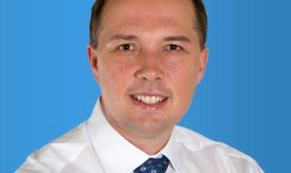 Dutton hits back over Manus