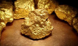 Gold strong, base metals weak